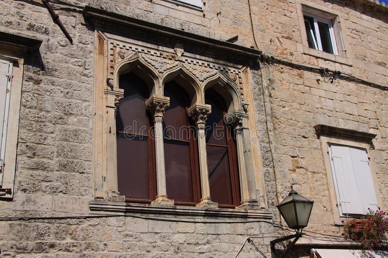 Gothic windows of the fifteenth-century Stafileo palace in Trogir Croatia. royalty free stock photo