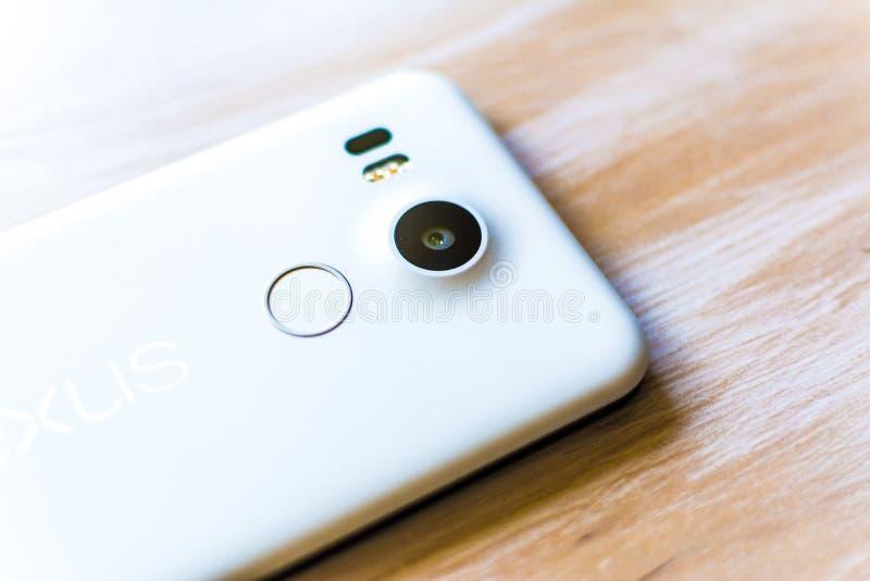 Nexus 5X. White Nexus 5X cover with camera, dual flash, adn Touch ID royalty free stock photo