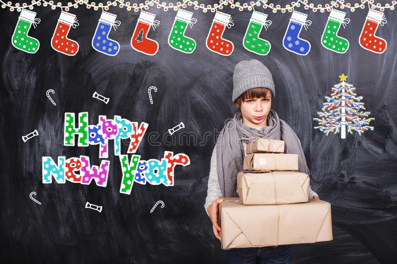 Ney year gifts from little boy stock photo