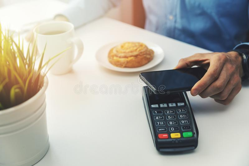 nfc payment with mobile phone stock image