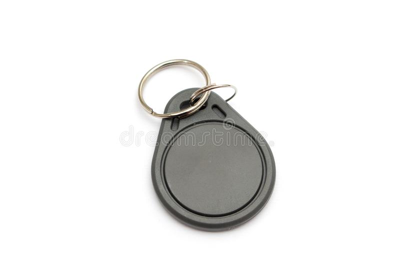 NFC tag, key chain. Against white background stock images