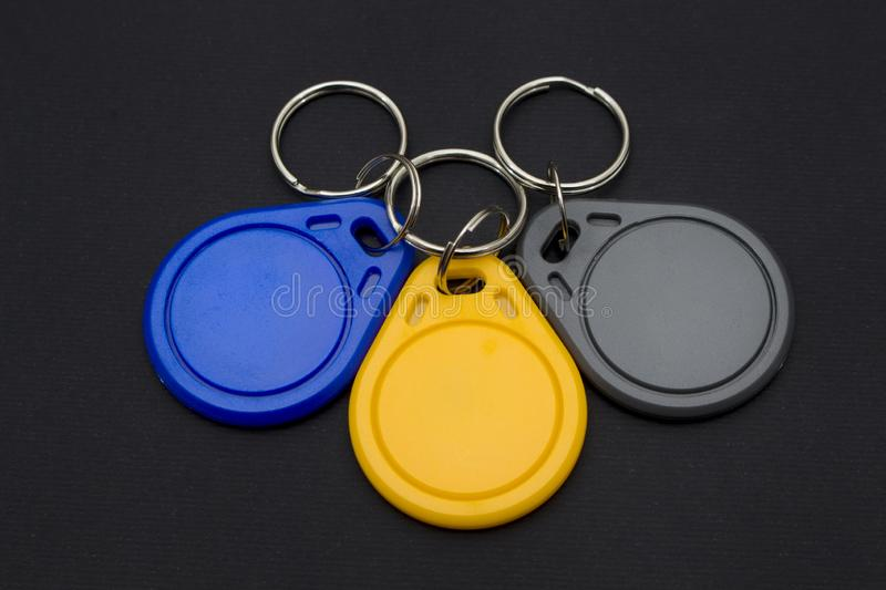 NFC tags, key chains. Against black background stock image
