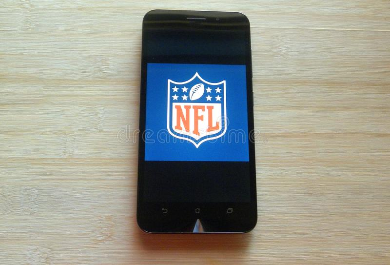 NFL app on smartphone royalty free stock image