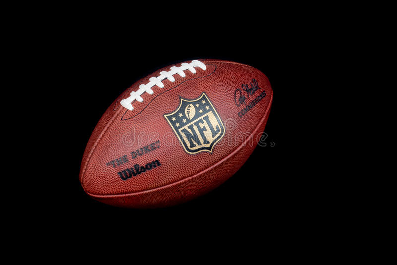 Nfl ball. ZAGREB , CROATIA - JANUARY 15 ,2014 : official american football NFL the duke by Wilson on black background , product shot royalty free stock images