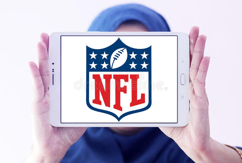 Nfl, National Football League logo. Logo of american nfl, National Football League, on samsung tablet holded by arab muslim woman stock images