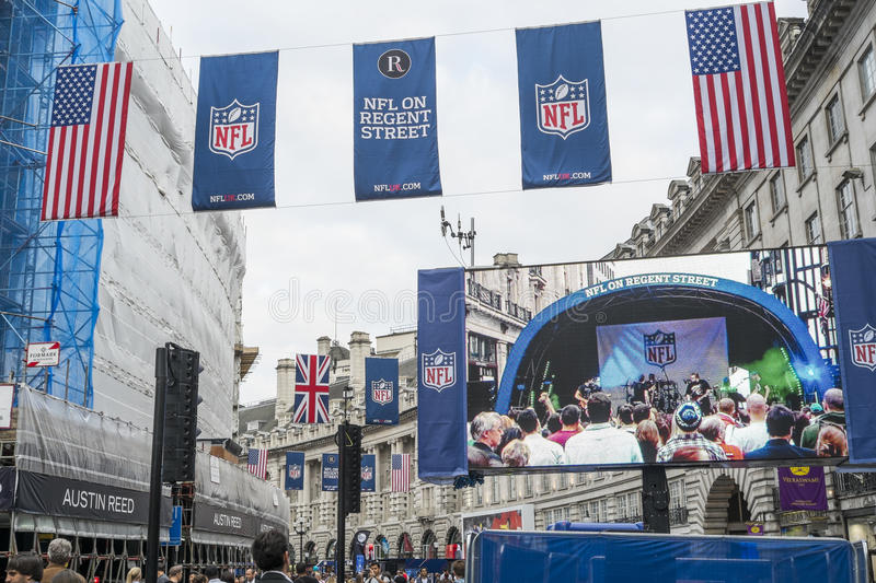 NFL on Regent Street. LONDON, UK - SEPTEMBER 27: American flag and NFL banners hanging above screen on Regent street. September 27, 2014 in London. Regent street stock image