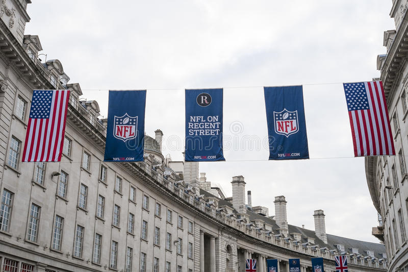 NFL on Regent Street. LONDON, UK - SEPTEMBER 27: American flag and NFL banners hanging above in Regent street. September 27, 2014 in London. Regent street was royalty free stock images