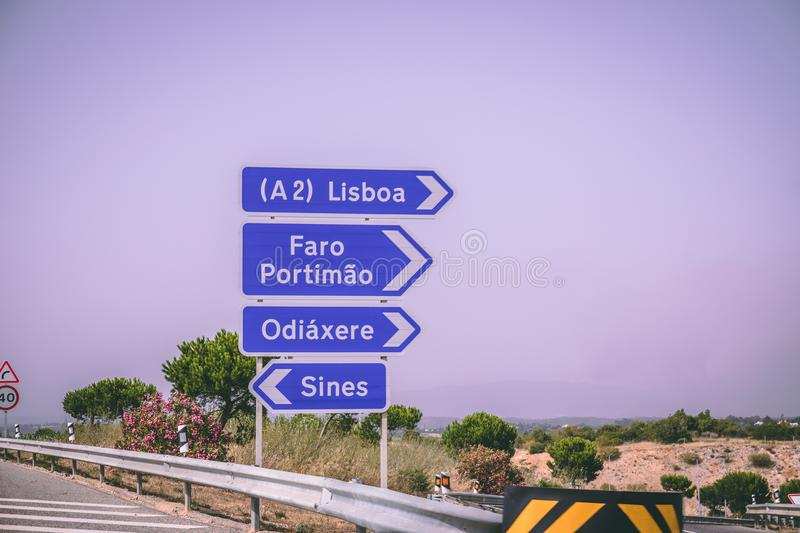Nformation road signs for Lisbon, Faro, Portimao, Odiaxere, and Sines on the Via do Infante road. stock image