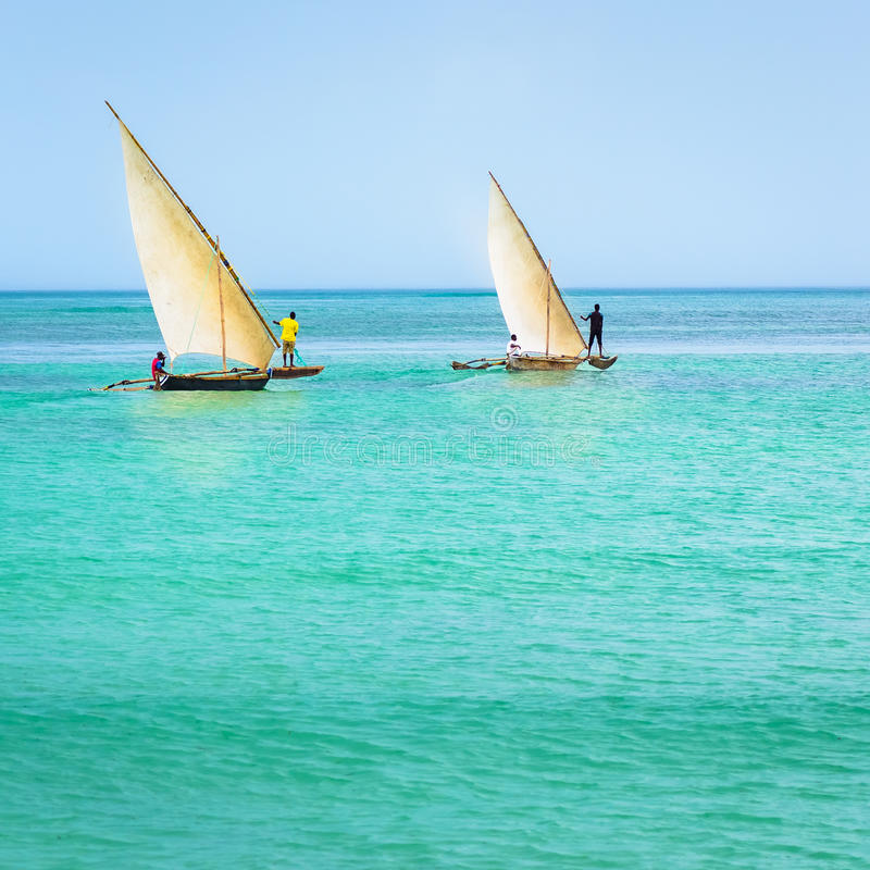 Ngalawa boats typical Zanzibar. In the picture two traditional catamarans(Ngalawa) on amazing turquoise water in the Indian ocean royalty free stock photo