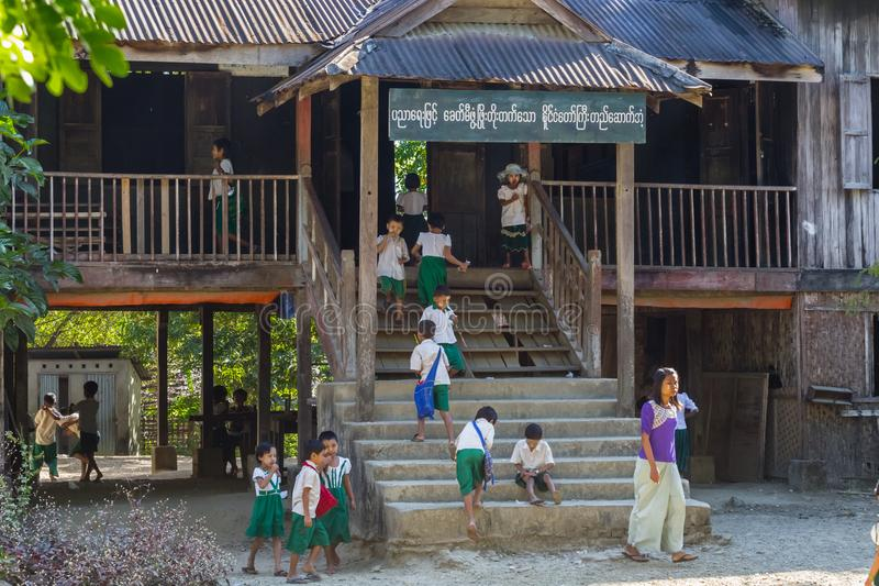 Child goes to elementary school in Ngapali beach, Myanmar stock photos