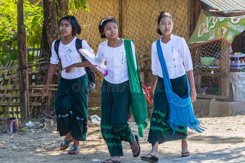 Child goes to elementary school in Ngapali beach, Myanmar stock photo