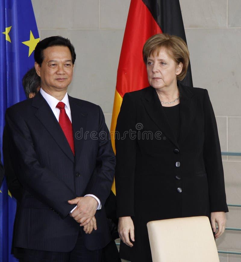 Nguyen Tan Dung, Angela Merkel lizenzfreie stockbilder