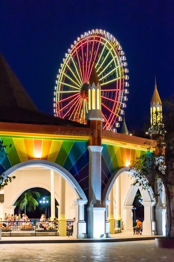 NHA TRANG, VIETNAM - APRIL 16, 2019: Glowing Ferris wheel at night at the amusement park Vinpearl. NHA TRANG, VIETNAM - APRIL 16, 2019: Glowing Ferris wheel at royalty free stock photo
