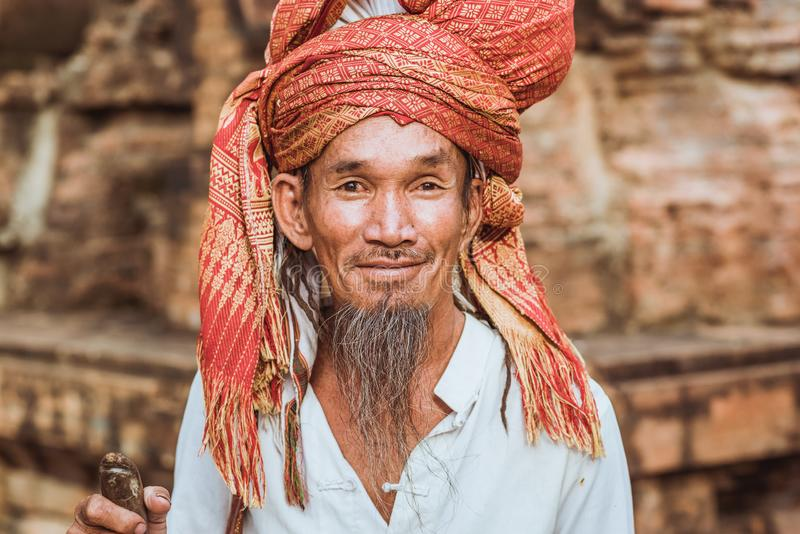 Nha Trang, Vietnam: a man with a beard and a headscarf, a visitor of Po Nagar Temple celebration. Nha Trang, Vietnam - May 5, 2018: a man with a beard and a royalty free stock images