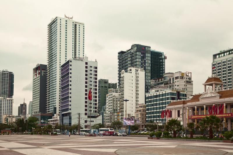 City of Nha Trang cityscape with high buildings and skyscrapers. Nha Trang, Vietnam - March 30, 2018: Asian town business center landscape. Text on the banners royalty free stock photography
