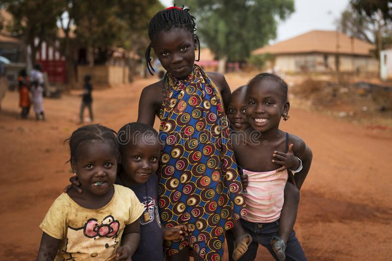 Portrait of a smiling group of children in the town of Nhacra in Guinea Bissau. Nhacra, Republic of Guinea-Bissau - January 28, 2018: Portrait of a smiling group royalty free stock images