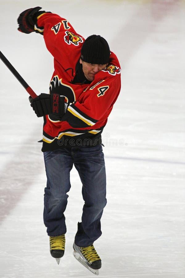NHL-Hockey Theo Fleury Skating Jumps stock afbeeldingen