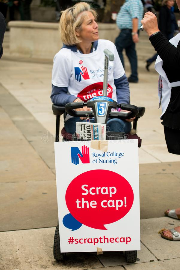 NHS - SCRAP THE CAP PROTEST. Scrap The Cap protest - Thousands of nurses gather at Parliament Square in London, UK, to campaign against the British government`s stock photos