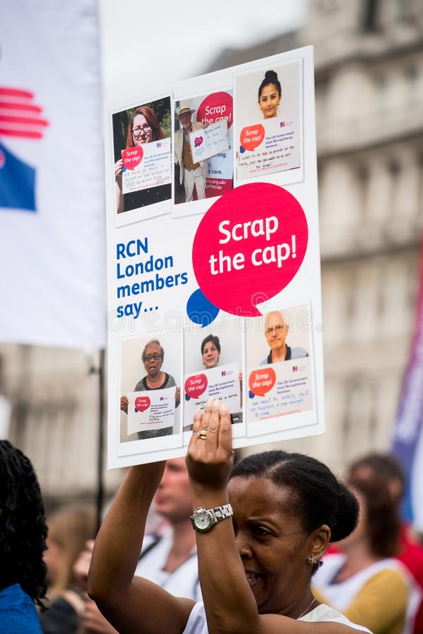 NHS - SCRAP THE CAP PROTEST. Scrap The Cap protest - Thousands of nurses gather at Parliament Square in London, UK, to campaign against the British government`s royalty free stock images