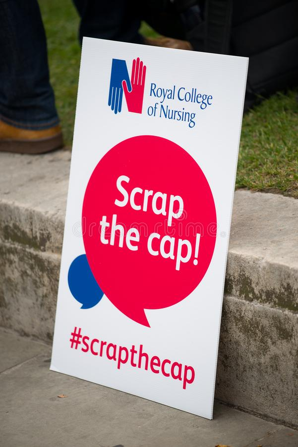 NHS - SCRAP THE CAP PROTEST. Scrap The Cap protest - Thousands of nurses gather at Parliament Square in London, UK, to campaign against the British government`s royalty free stock image