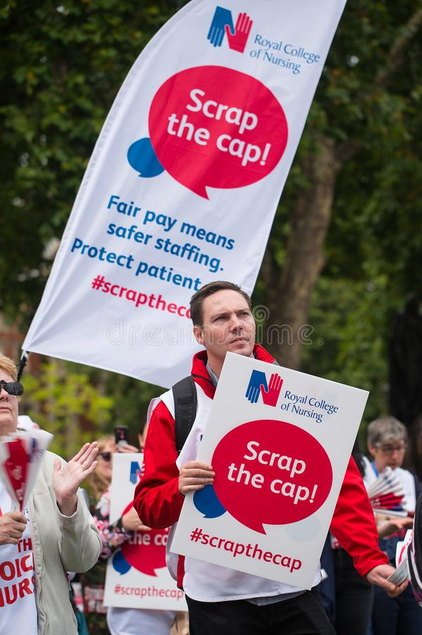 NHS - SCRAP THE CAP PROTEST. Scrap The Cap protest - Thousands of nurses gather at Parliament Square in London, UK, to campaign against the British government`s stock photo