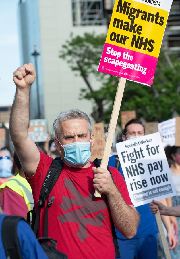NHS workers protest, demanding a pay rise from the British Government. stock photos
