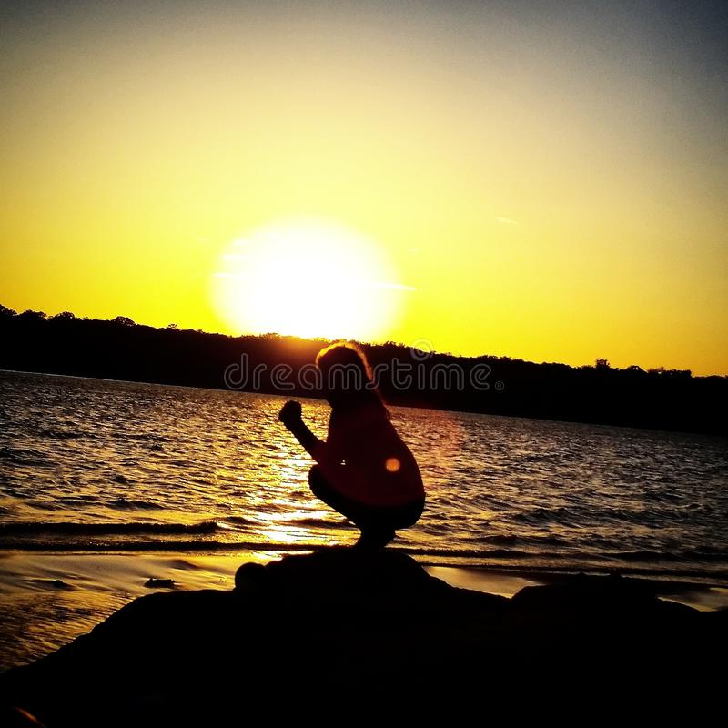 Nièce, coucher du soleil, thunderbird de lac image libre de droits