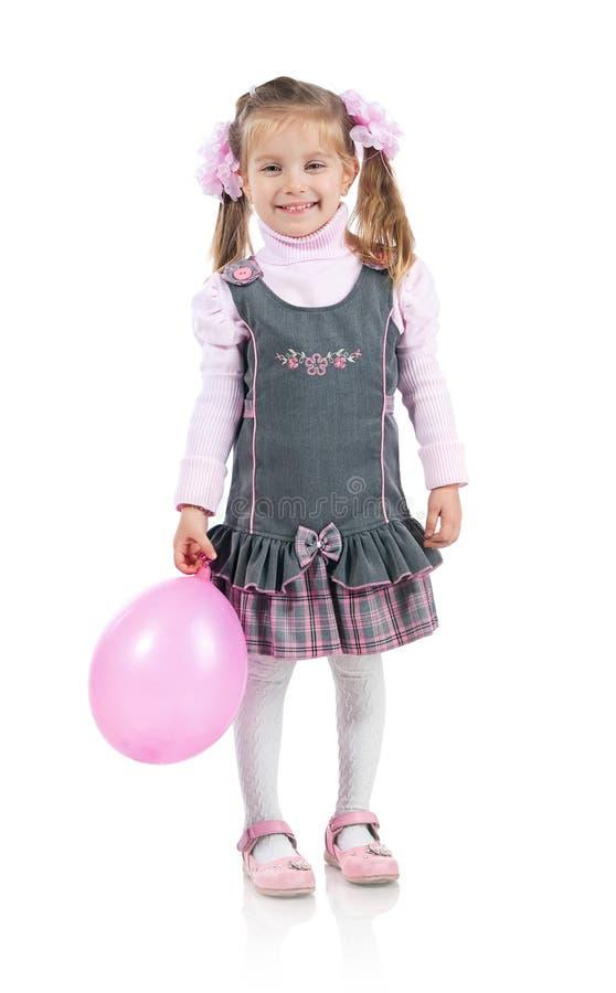 Niña bonita con el globo fotografía de archivo