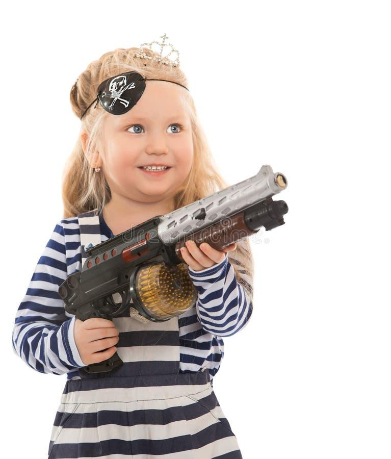 Niña con el arma del juguete fotografía de archivo libre de regalías