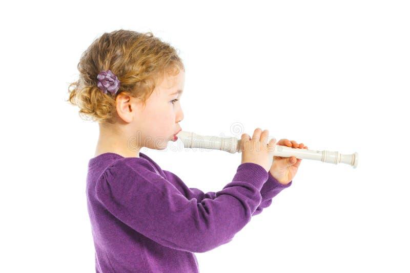 Niña con la flauta imagen de archivo