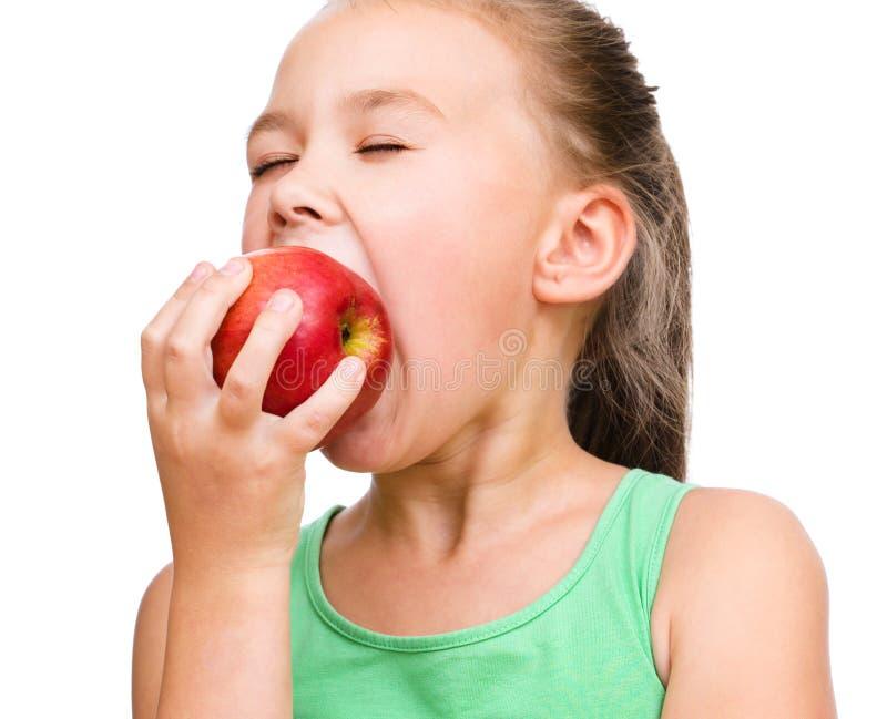 Niña con la manzana roja foto de archivo libre de regalías