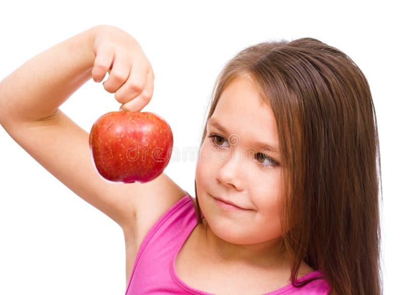 Niña con la manzana roja fotos de archivo libres de regalías