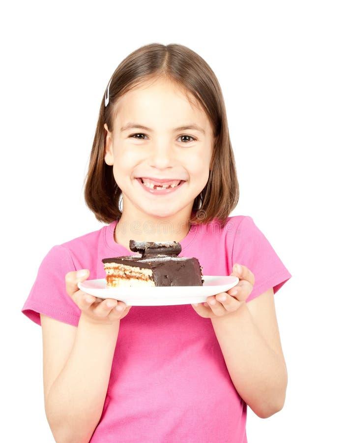 Niña con la torta de chocolate fotos de archivo