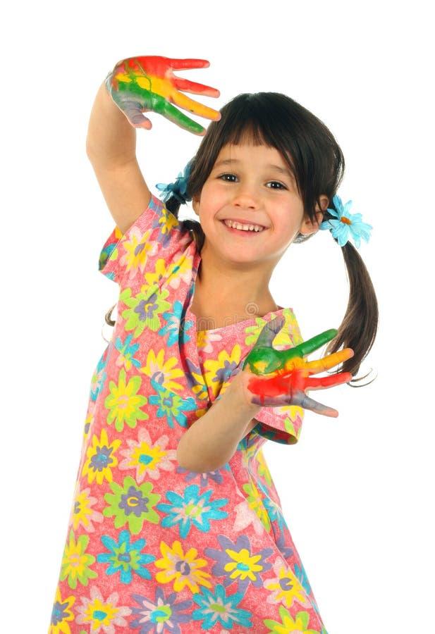 Niña con las manos pintadas fotografía de archivo libre de regalías