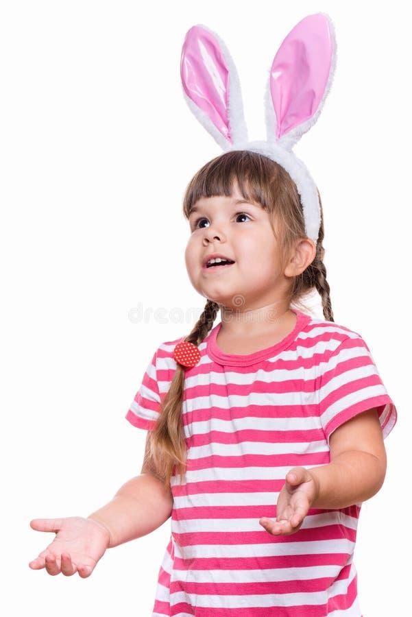 Niña con los oídos de conejo imagen de archivo