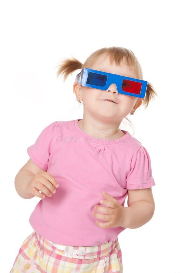 Niña con los vidrios 3D foto de archivo libre de regalías