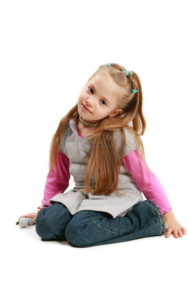 Niña con sonrisa triste foto de archivo libre de regalías