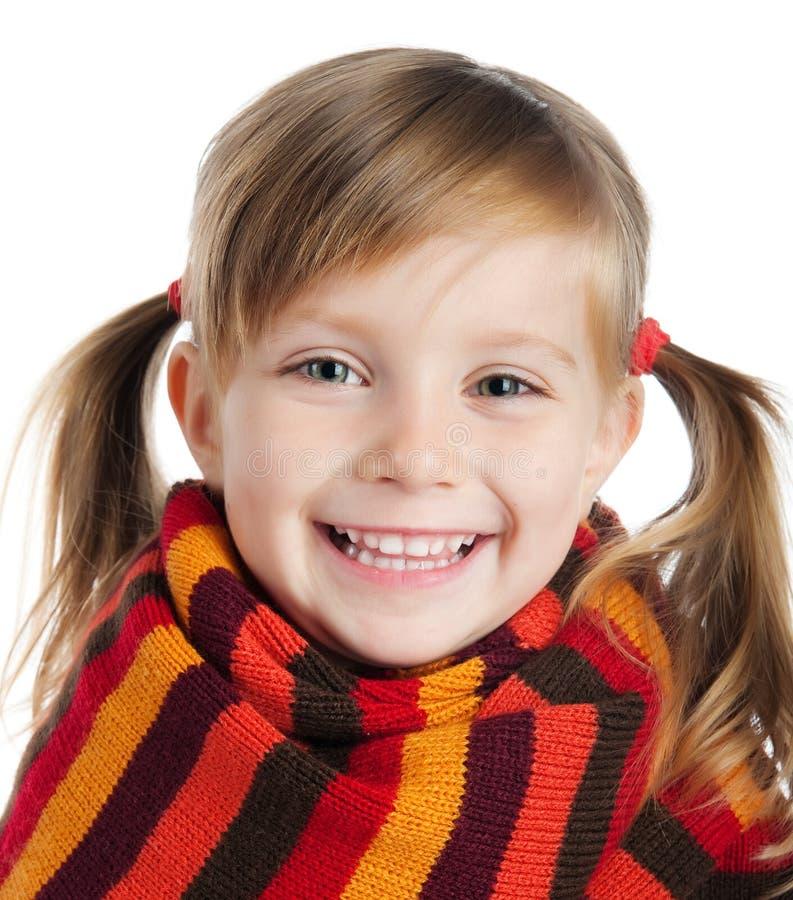 Niña en bufanda rayada fotografía de archivo