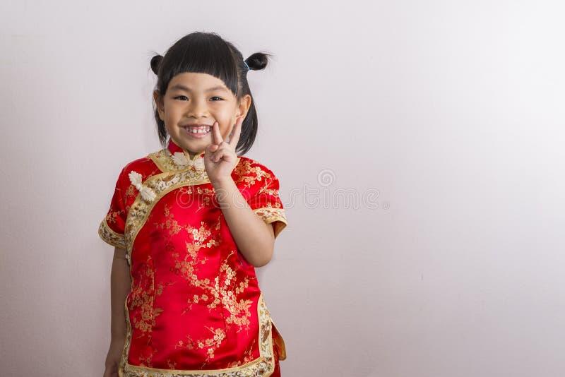 Niña en chino vestido imágenes de archivo libres de regalías