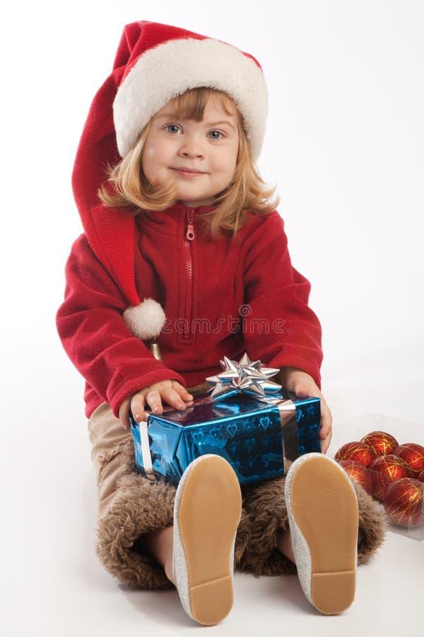 Niña en el sombrero de Santa foto de archivo