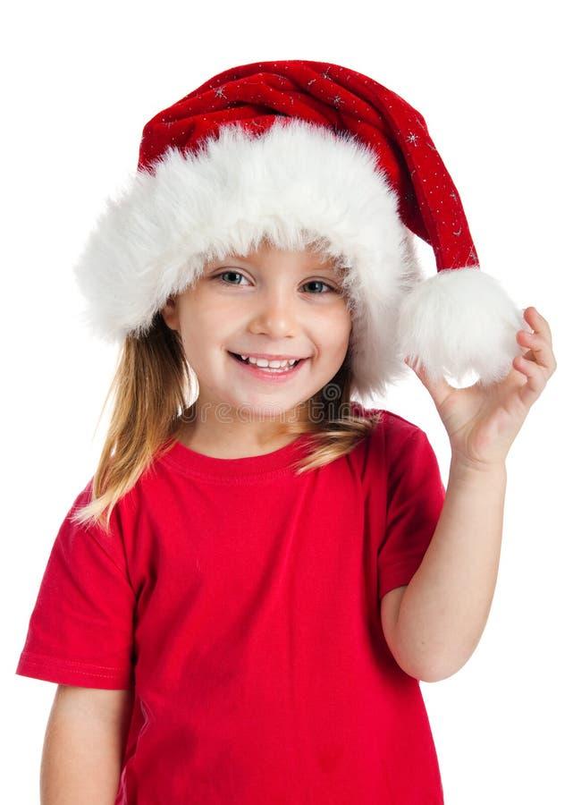 Niña en un sombrero de Papá Noel fotografía de archivo libre de regalías