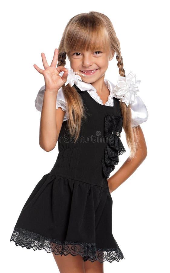 Niña en uniforme escolar foto de archivo