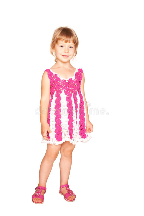 Niña feliz en vestido rosado hecho punto. fotos de archivo
