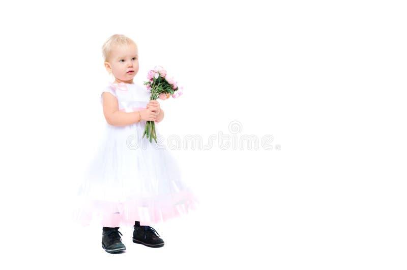 Niña hermosa con las flores foto de archivo libre de regalías
