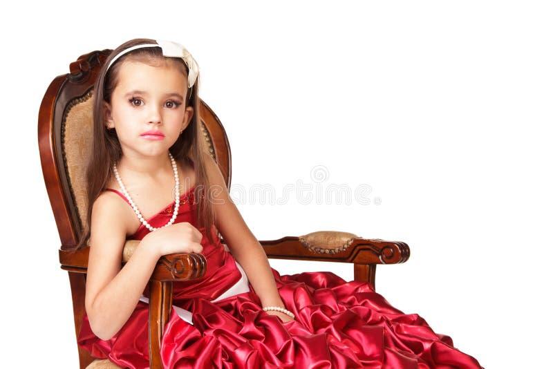 Niña hermosa en vestido de noche rojo fotos de archivo libres de regalías