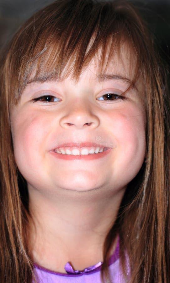 Niña sonriente fotos de archivo