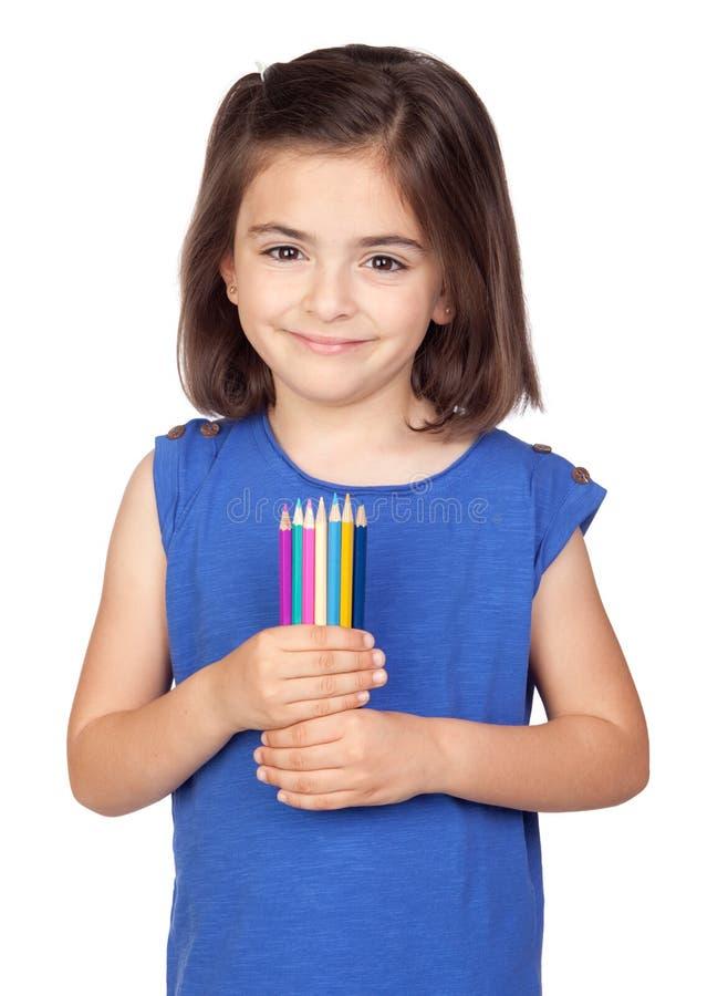 Niña triguena con el lápiz coloreado imagenes de archivo