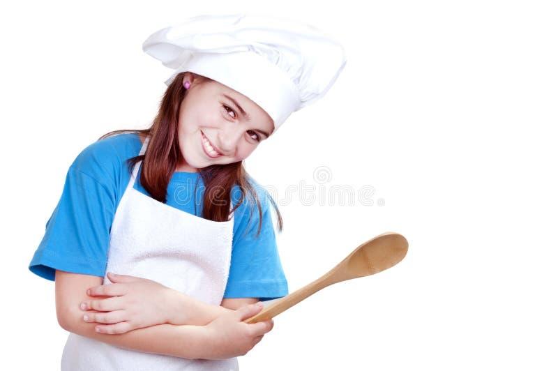 Niña vestida como cocinero fotografía de archivo