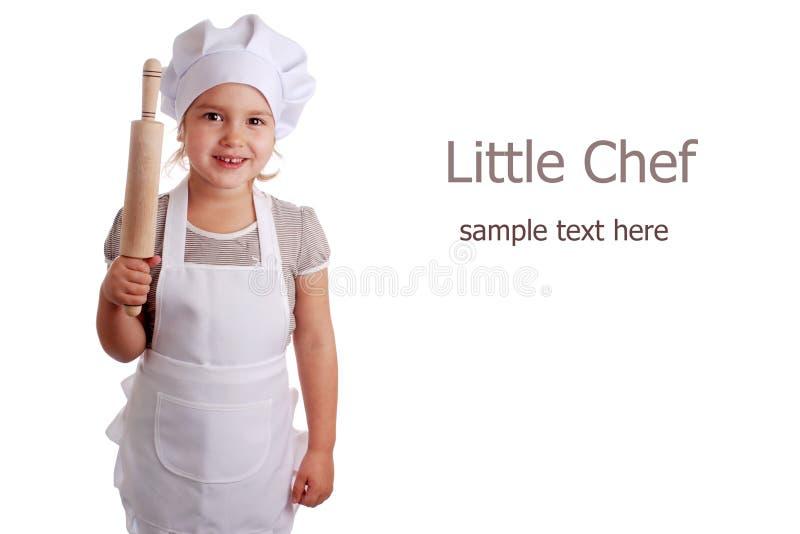 Niña vestida como cocinero foto de archivo libre de regalías