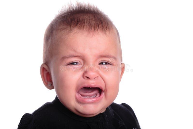 Niñera que introduce al bebé fotografía de archivo libre de regalías